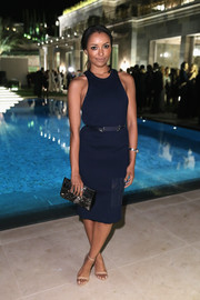 Kat Graham was sporty-sexy in a navy racerback dress by Calvin Klein at the Women in Film event in Cannes.
