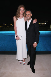 Chiara Ferragni finished off her all-white look with a pair of T-strap platform peep-toes, also by Calvin Klein.