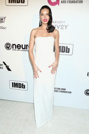 Adriana Lima kept it minimal in a strapless white column dress by Alex Perry at the Elton John AIDS Foundation Oscar-viewing party.