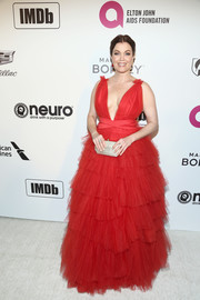 Bellamy Young looked enchanting in a red princess gown by Vitor Zerbinato at the Elton John AIDS Foundation Oscar-viewing party.