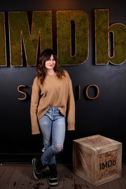 For her footwear, Kathryn Hahn chose a pair of black-and-white snow boots.