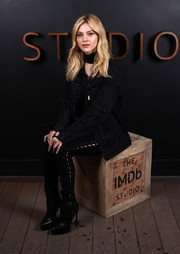 Nicola Peltz completed her outfit with chic black platform boots.