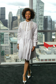 Gugu Mbatha-Raw looked cute in a loose white shirtdress with bib detailing at the IMDb Studio event during the 2018 Toronto International Film Festival.