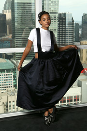 Amandla Stenberg kept it youthful in a black pinafore skirt at the IMDb Studio during the 2018 Toronto International Film Festival.
