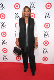 Queen Latifah smartened a long-sleeve white tee with a black tuxedo vest for the IMG + Target official NYFW kickoff.