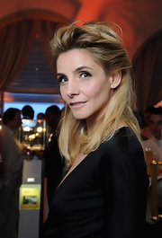 Julie Gayet attended the IWC Filmmakers Dinner wearing her textured hair in a voluminous partial updo.