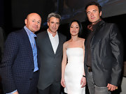 Julian McMahon's iridescent charcoal blazer was an elegant complement to his washed-out jeans.