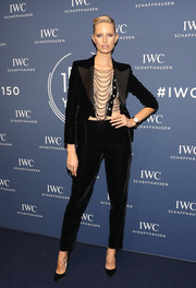Karolina Kurkova wowed in a black Armani velvet pantsuit teamed with a chain top at the IWC Schaffhausen Gala.
