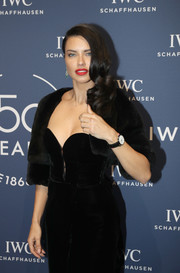Adriana Lima layered a cropped fur jacket over a strapless dress for the IWC Schaffhausen Gala.