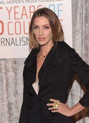 Dawn Olivieri spiced up her look with an extra-large gold fan ring for the IWMF Courage in Journalism Awards.