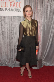 Holland Roden chose a textured black skirt to complement her blouse.