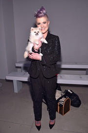 Kelly Osbourne was business-glam in a sequined pantsuit by Idan Cohen during the label's fashion show.