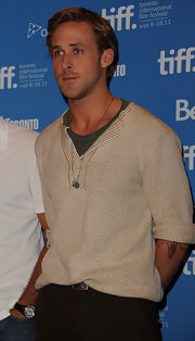Ryan Gosling wore a cozy knit top as he flashed the crowd a pensive look at the press conference of 'The Ides of March.'