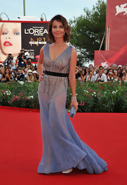 Violante Placido opted for a lavender gown at the Venice Film Festival. The gown featured a banded waist, detailed beading on the bodice and a subtle train.