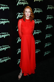 Karen Elson was red hot at the 'Tonight We Tanqueray' launch wearing a red Gucci evening gown. The long dramatic gown featured sheer sleeves and was the perfect statement piece for the red-headed model.