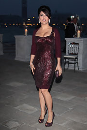 Salma Hayek sizzled at the 54th International Art Biannale in maroon python Sofia peep-toes.