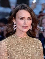 Keira Knightley completed her stunning look with a pair of David Morris diamond chandelier earrings.