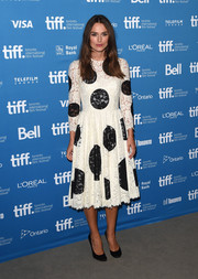Keira Knightley toned down her look with a pair of black pumps for 'The Imitation Game' press conference at the 2014 Toronto International Film Festival.