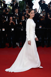 Marion Cotillard was a vision of elegance in this long-sleeve white gown that featured a ruffle detail on the side and a flowing train.
