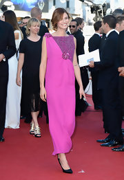 Bianca Balti wore a fuchsia-colored square dress with floral appliques to the premiere of 'The Immigrant.'