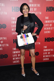 Alicia Quarles pulled her outfit together with a rainbow-striped tote.