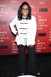 Oprah Winfrey completed her casual look with black flare pants.