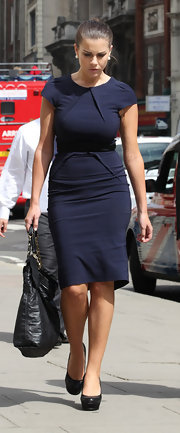 Imogen Thomas teamed her ladylike navy dress with black leather platform pumps.