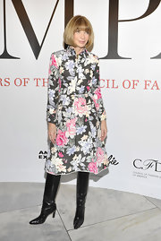 Anna topped off her floral frock with black leather boots.