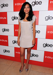 Naya Rivera added shine to her lovely nude frock with sparkly silver and gold peep toes.