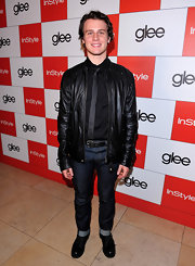 Jonathan Groff shows up in true Glee style with a leather jacket over his skinny tie and tight cuffed blue jeans.