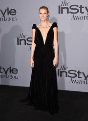 Gwyneth Paltrow looked opulent at the InStyle Awards in a black Schiaparelli Couture velvet gown with a navel-grazing plunge and a crystal accent across the shoulders.