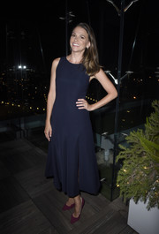 Sutton Foster opted for a simple navy midi dress when she attended the InStyle Badass Women dinner.