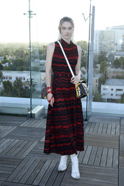 Hunter Schafer attended the InStyle Badass Women dinner wearing a red and black patterned knit dress by Missoni.