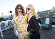 Patricia Clarkson attended the InStyle Badass Women dinner carrying a 'Women of the world, unite!' velvet clutch.