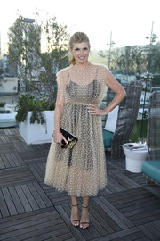 Connie Britton looked lovely in a sheer, dotted nude dress with a black underlay at the InStyle Badass Women dinner.