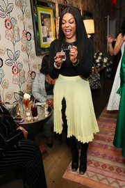 Taraji P. Henson attended the InStyle Badass Women dinner wearing a long-sleeve black bodysuit by Wolford.