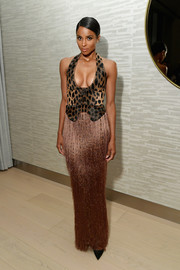 Ciara paired her top with a metallic fringed maxi skirt, also by Tom Ford.