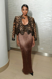 Ciara layered a leopard-print leather jacket over a matching halter top by Tom Ford for the InStyle dinner celebrating the April issue.
