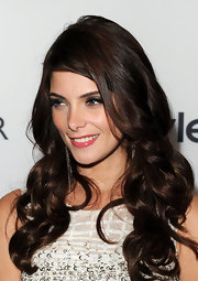 Ashley Greene wore her hair in soft, cascading curls at the Toronto International Film Festival. To try her look at home, set two-inch sections vertically on hot rollers. To finish, spritz hair with a sheer-hold hairspray and tousle with fingers.