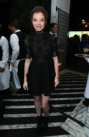 Hailee Steinfeld looked adorable in a black lace up ankle boots, which she wore with a unique lacy dress.