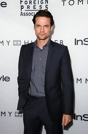 Shane West layered a black suit jacket over a gray button-down shirt for a totally polished look.