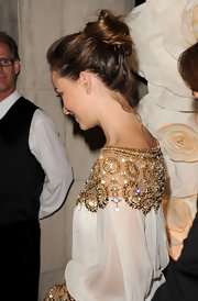 Olivia Wilde worn her hair in a loose bun to the 2011 Toronto International Film Festival. Her casual style is simple to duplicate. Just pull hair away from the face and secure into a a high ponytail. Next, twist ponytail around the hair elastic and secure ends with a few bobby pins.