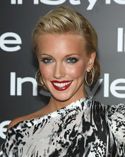 Katie Cassidy rocked a smoky metallic eye and wispy lashes which added high drama to her perfect red pout.