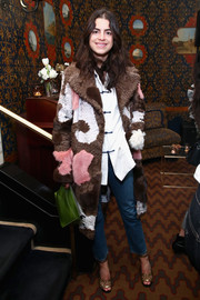 Underneath her coat, Leandra Medine was casual in cropped jeans and an Oriental-inspired shirt.