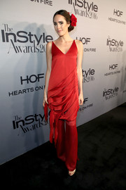 Louise Roe matched her dress with a pair of red silk pants, also by C/MEO Collective.