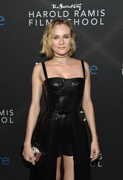 Diane Kruger arrived for the inaugural IndieWire Honors carrying an embroidered leather clutch by Dior.