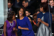 Michelle Obama looked charming in a cropped blue cardigan layered over a silver dress during the Inaugural Parade.