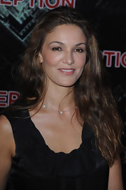 Nadia paired her long brunette curls with a black sleeveless top while walking the red carpet.