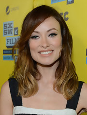Olivia Wilde let her dark cat eyes be the center of attention by opting for a basic nude lip.