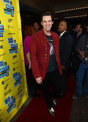 Funny man Jim Carrey matched the red carpet at SXSW with this double breasted red suede jacket.